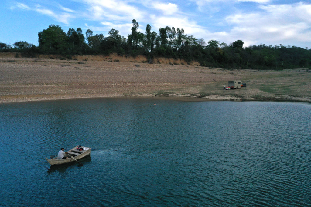 """<img src=""""boating lakeside caravan offbeat camp.jpeg"""" alt=""""private quiet boating campervan village vacation overlanding overland truck vanlife lakeside campexperience wilderness caravan for best family holiday and couplepong dam himachal pradesh"""">"""