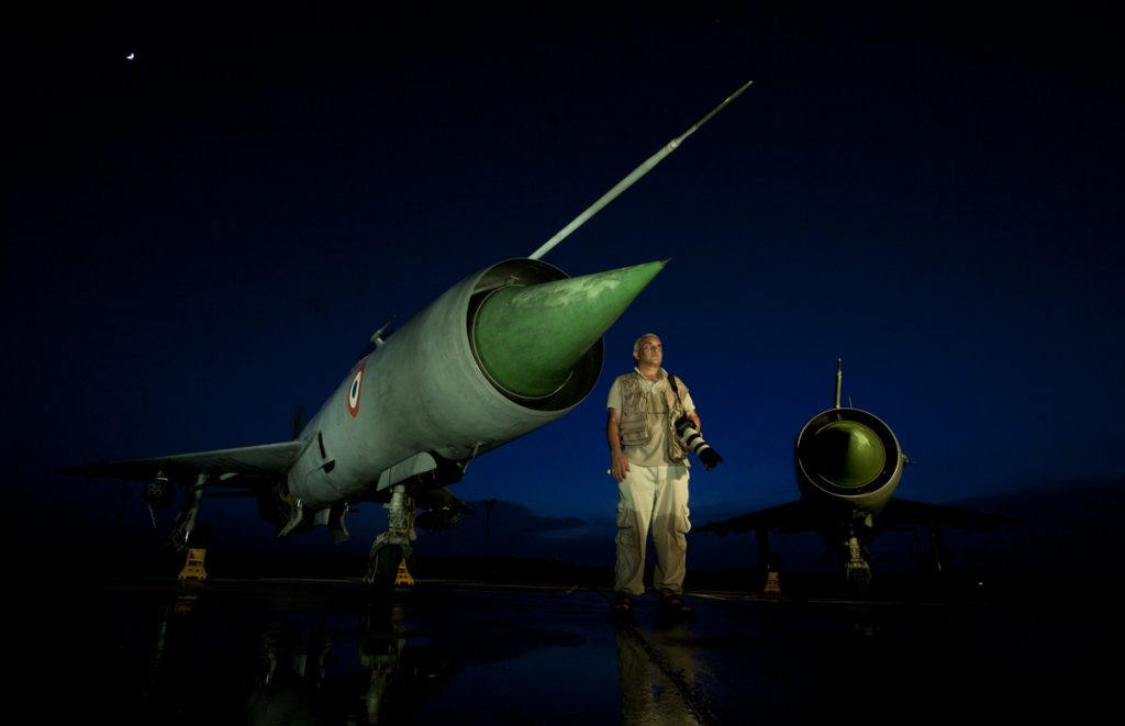 "<img src=""capt suresh sharma with MiG21"" alt="" capt suresh, team leader of green dot expeditions, photographed MiG21 with elinchrom quadra ranger for a coffee table table"">"