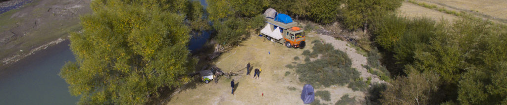 """<img src=""""family holidays offbeat village camp.jpeg"""" alt=""""soft adventure campervan vacation overlanding holiday onboard overland truck vanlife withweberbarbecue grill food experience wilderness with caravan and campervan for best family vacations pong dam himachal pradesh"""">"""