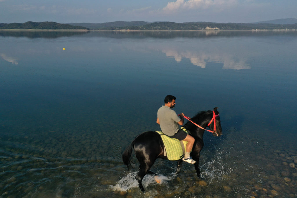 """<img src=""""horse riding lakeside caravan offbeat camp.jpeg"""" alt=""""horse riding campervan vacation overlanding overland truck vanlife lakeside campexperience wilderness caravan for best family holiday and couplesweber barbecuepong dam himachal pradesh"""">"""