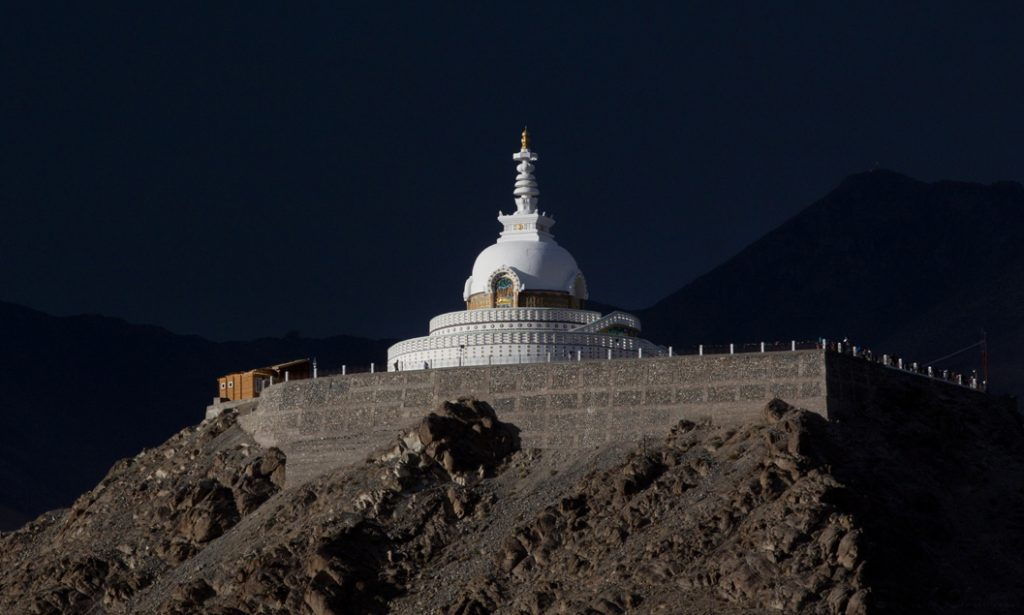 """<img src=""""photo tour shanti stupa in ladakh caravan.jpeg"""" alt=""""shanti stupa best photo tour for landscape astrophotography escorted curated and guided with caravan campervan ladakh in offbeat locations"""">"""