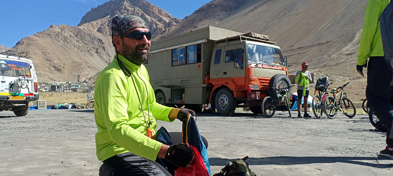 """<img src=""""cycling expedition with caravan campervan ladakh.jpeg"""" alt=""""offbeat stay in campervan camp and overland truck on the move in wilderness nomadic with all comforts of caravan camping best energy food logistical support ladakh"""">"""