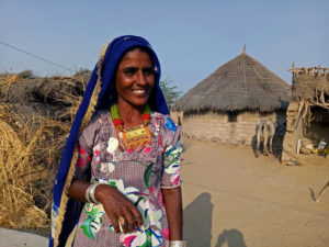 "<img src=""border village rajasthan.jpeg"" alt=""village woman smiling and village life in huts at its best"">"
