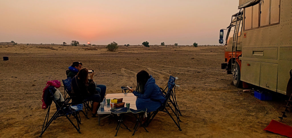 "<img src=""campervan caravan camp in wilderness sunrise.jpeg"" alt=""caravan campervan offbeat overlanding camp thar desert setting  for unique night experience and private sunrise family holidays with comfort jaisalmer rajasthan india"">"