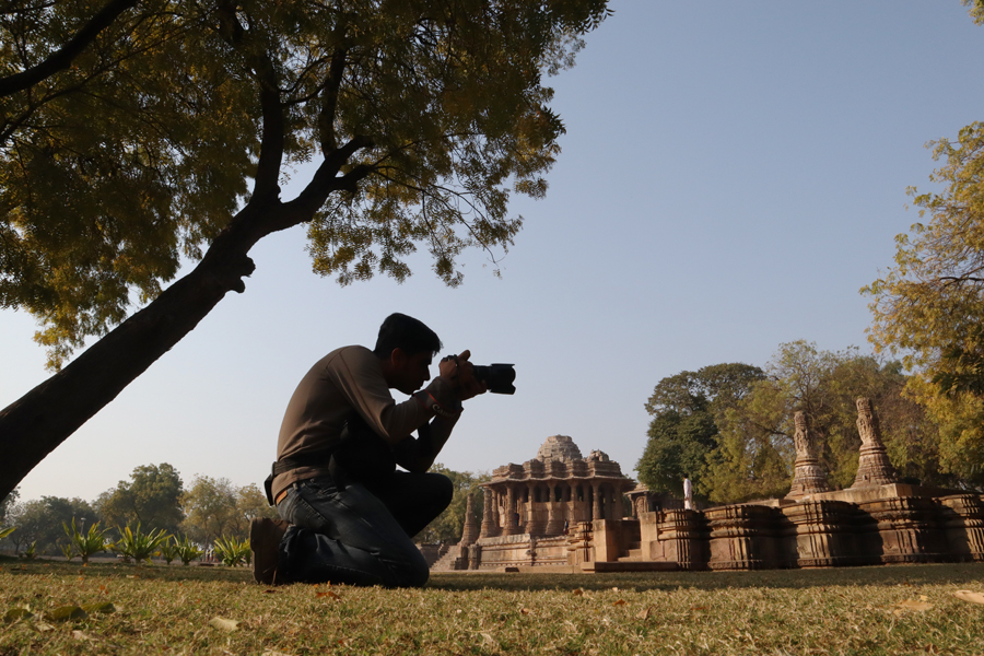 "<img src=""photographer at modhera sun temple.jpeg"" alt=""photographer shooting best escorted and guided photo tour with campervan overland truck nomadic caravan holiday unique lifetime experience offbeat outdoor overlanding camp to relax unwind quiet place at secluded locations in gujarat"">"