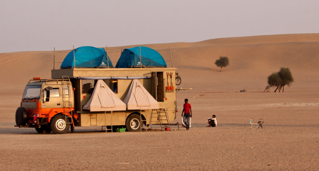"<img src=""caravan camping offbeat exotic locations india.jpeg"" alt=""caravan campervan overland truck nomadic holiday for families couples romantic unique lifetime experience offbeat outdoor camp to relax unwind quiet place at secluded locations vanlife jaisalmer rajasthan india"">"