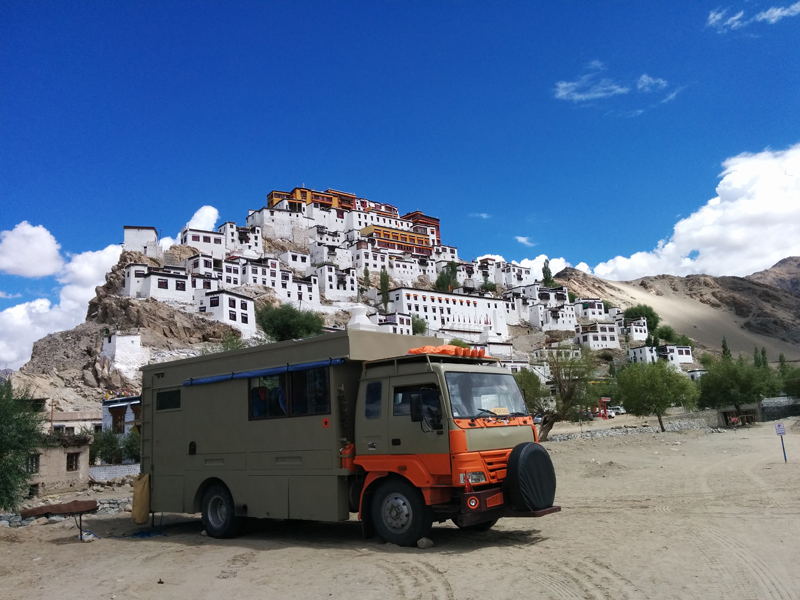 """<img src=""""caravan overland truck at thiksey.jpeg"""" alt=""""best photo tour offbeat location overlanding riverside caravan campervan for photographers families couples secluded quiet peaceful camp location barbecue hygienic camp ladakh"""">"""