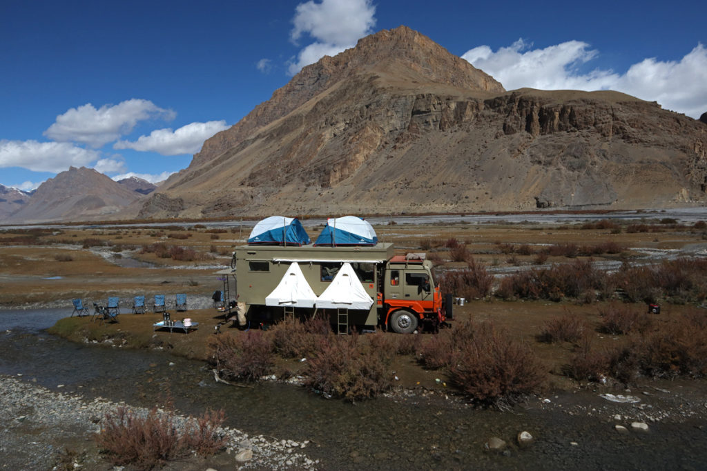 "<img src=""caravan campervan RV camp spiti valley.jpeg"" alt=""caravan RV recreational vehicle photo tour experience culture with campervan Taurus overland truck, luxury nomadic unique experience of offbeat outdoor overlanding camp for best photography rural india spiti valley"">"