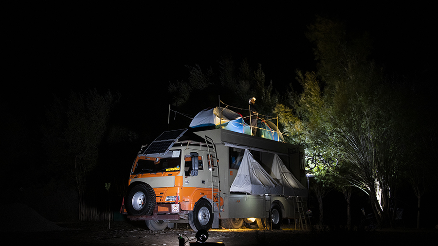 "<img src=""photo tour caravan campervan camp.jpeg"" alt=""flash photography caravan RV recreational vehicle photo tour experience culture with campervan Taurus overland truck, luxury nomadic unique experience of offbeat outdoor overlanding camp for best travel photography rural india"">"