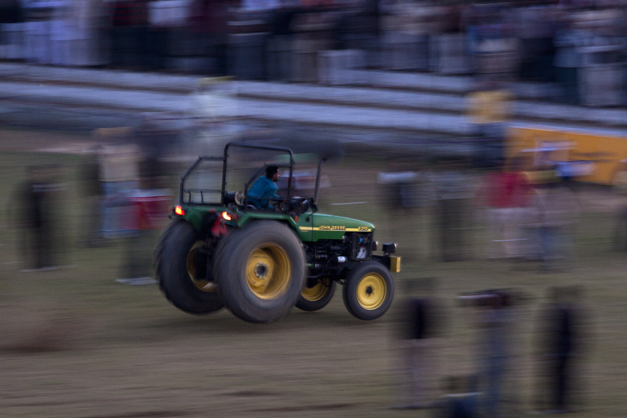 """<img src=""""tractor race at rural games.jpeg"""" alt=""""best photo tour experience punjabi culture, festivals and folk art luxury nomadic unique experience of outdoor overlanding camp for best photography at rural games and events at kilaraipur rural games"""">"""