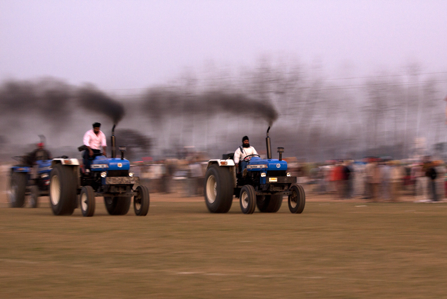 """<img src=""""tractor race at kilaraipur.jpeg"""" alt=""""best photo tour experience punjabi culture, festivals and folk art luxury caravan nomadic unique experience of outdoor overlanding camp for best photography at rural games and events kilaraipur punjab"""">"""